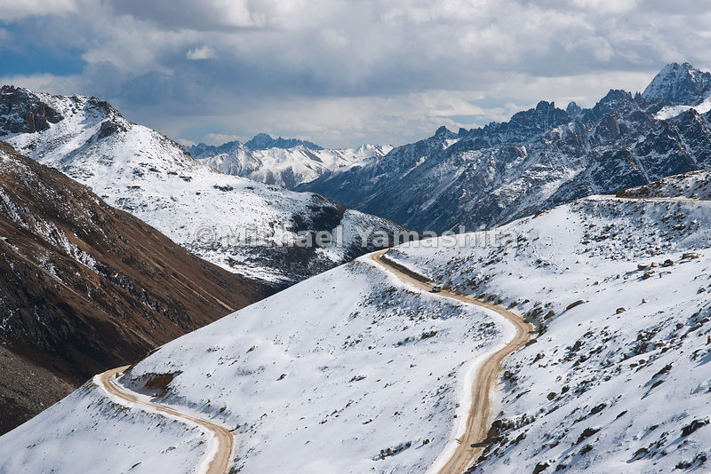 The road at the top of the 16,400 ft (5,100 m) Trola Pass, which lies between Dege and Manigango, is covered with snow for mo...