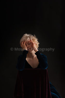 young blond woman on black background - studio shot - nostalgic ambiance.free space for text