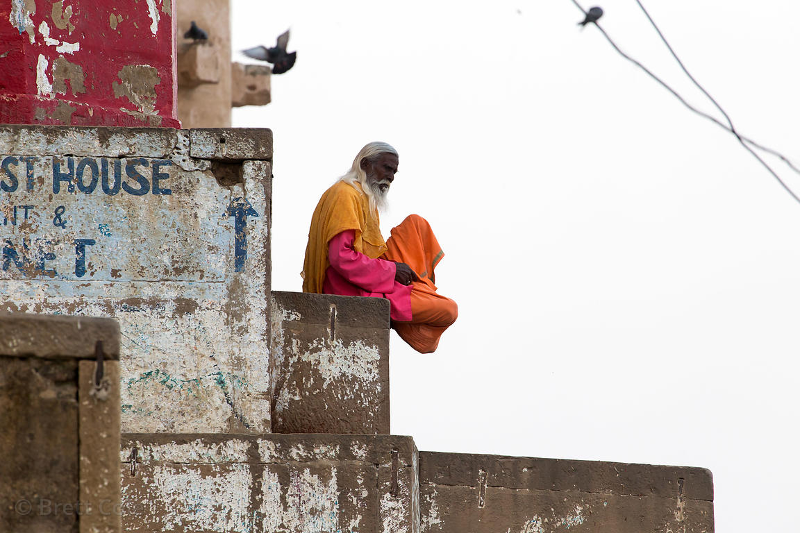 A sadhu meditates on a ghat along the Ganges River, Katesar, Varanasi, India