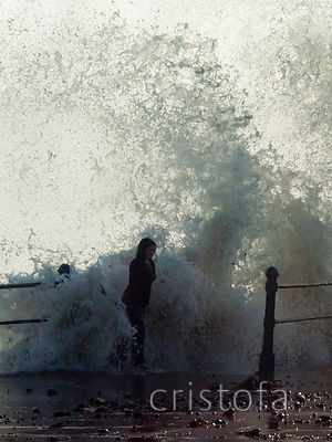 a girl gets wet on the Penzance seafront