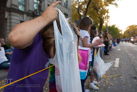 Lauraya checks her candy bag for how much she has acquired during the  University of Iowa homecoming Parade in Iowa City on F...