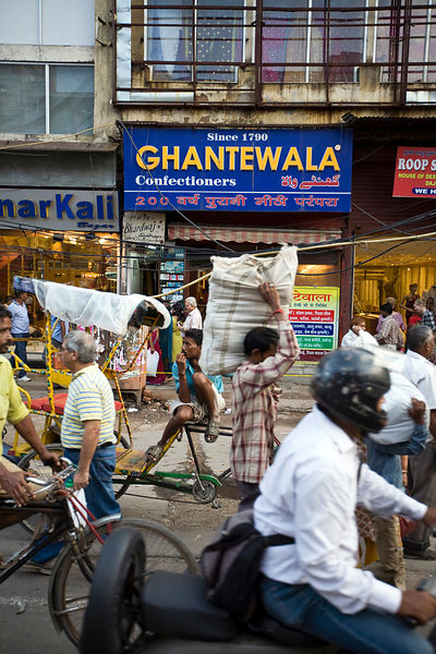 India - Delhi - Traffic outside Ghantewala Confectioners on Chadni Chowk