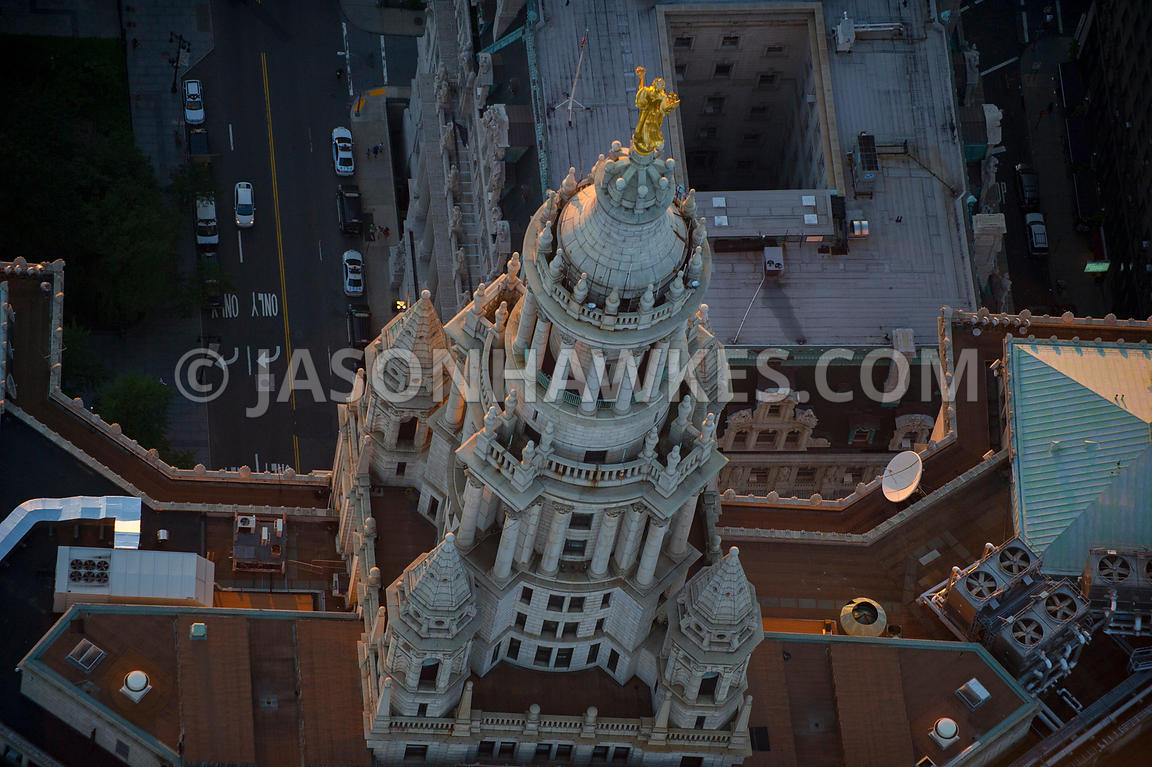 Close up aerial view of the statue of Civic Fame on top of the Manhattan Municipal Building