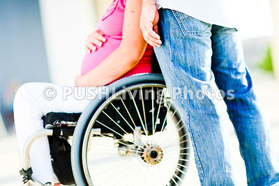 Young mother to be in a wheelchair