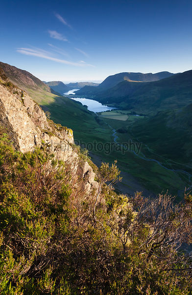 Sun rising over Lake Buttermere from the summit of Haystacks in the Lake District, England, UK.