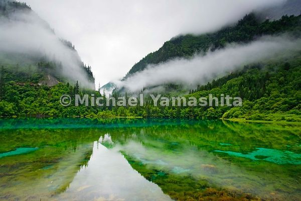 Five Fower Lake reflects the heavenly mist of Jiuzhaigou Nature Preserve in northwest Sichuan Province.