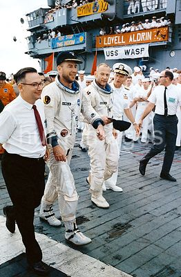15 Nov. 1966 - A happy Gemini-12 prime crew arrives aboard the aircraft carrier, USS Wasp. Astronauts James A. Lovell Jr. (L)...