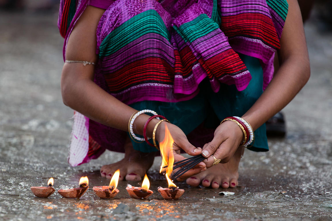 A woman prays for deceased relatives during Mahalaya, Kolkata, India