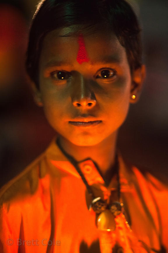 A boy is illuminated by candlelight, Pushkar, Rajasthan, India