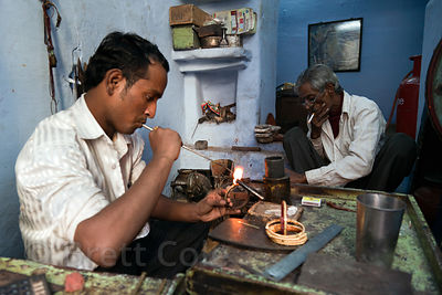 Father and son in their shop making gold bangles, Rajasthan, India