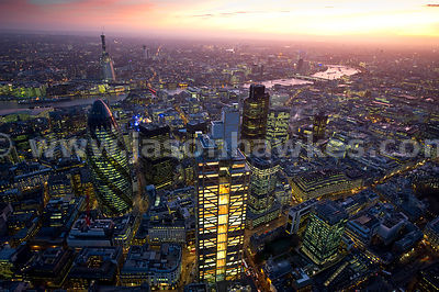 Aerial view over City of London at sunset