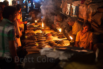 Fish for sale at night at a market in the Kokri Agar slum, Mumbai, India.
