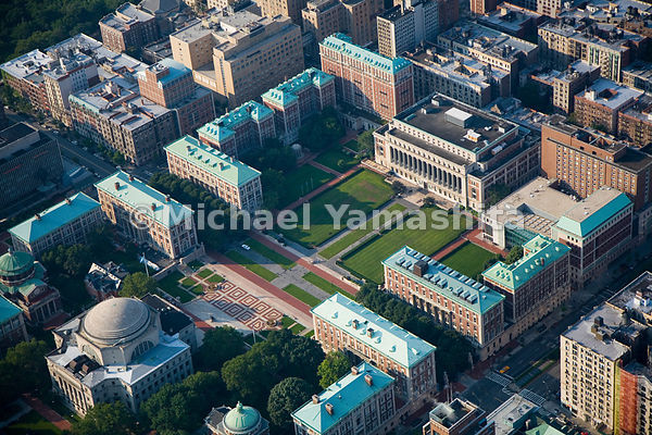 Columbia University, with its distinctive green rooftops, dominates Morningside Heights, and its two libraries, Lowe and Butl...