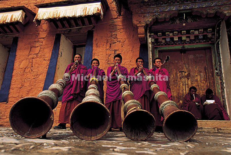 Music lesson for Labrang's monks using the traditional 13-foot horns. Tibet.