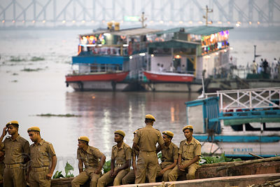 Police regulate the immersion of Durga Puja idols in the Hooghly River, Babughat, Kolkata, India