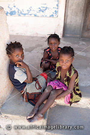 Children sitting in the street, Ibo island, Mozambique