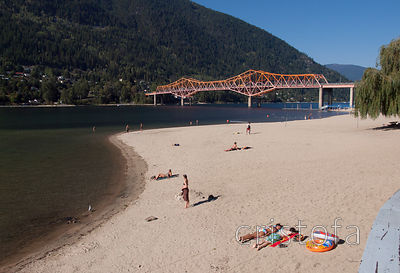 Nelson beach on Kootenay Lake and the Orange Bridge