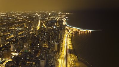 Bird's Eye: Night Time Grids Of Gold Over Northern Chicago Skyline & Lakefront