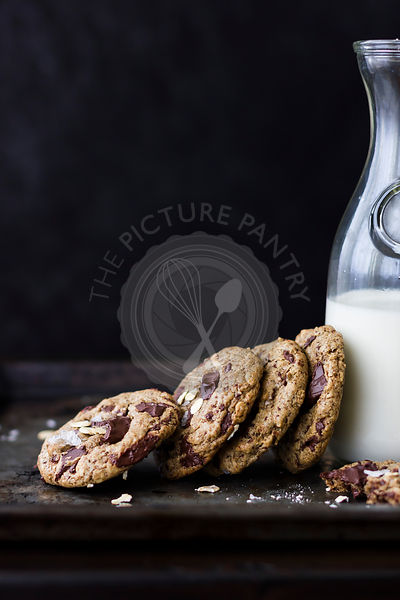 chocolate chunk cookies with oats, sea salt, and carafe of milk