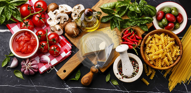 Italian food ingredients with Olives, pasta Spaghetti, Oil, Parmesan cheese, Brown mushroom, Tomato, Garlic, Basil, Chilli pe...