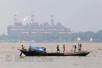 Fishermen on the Hooghy River in Kolkata India pass a large factory reported to make leather handbags. Search my catalog for ...