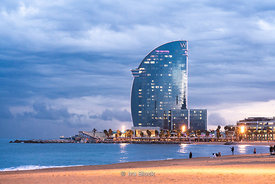 A night time view of the W Hotel, designed by the architect Ricardo Bofill, on the Barceloneta beach on the port of Barcelona.