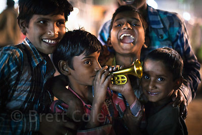 Children celebrate at a carnival at the Pushkar Camel Mela, Pushkar, Rajasthan, India.