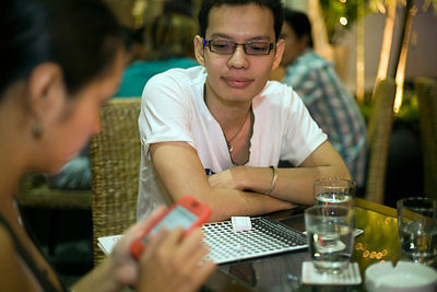 A couple dining in an upscale restaurant, Ho Chi Minh City, Vietnam