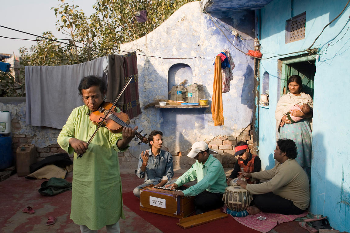 Traditional musicians play on a roof top in Chandni Mahal, Old Delhi, India