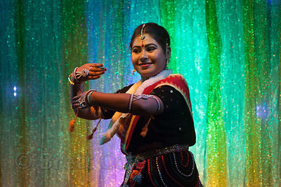 Dancers perform under colored lights at Tara Maa Puja in Lord's More, Kolkata, India.
