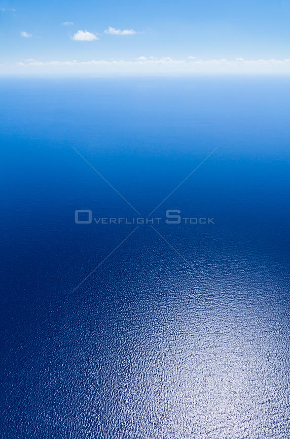 Aerial view of light reflected on deep blue sea around the Bahamas archipelago, Caribbean. February 2012.