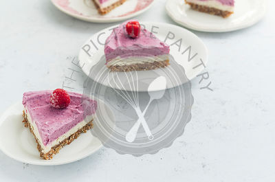 Raw cashew cake with raspberries