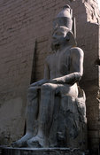 Colossal statue of Rameses II on his throne in the Temple of Luxor, Luxor, Egypt