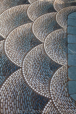 Detail of the decorative pebble paving in 'A Beekeeper's Garden' at RHS Hampton Court Flower Show. © Rob Whitworth