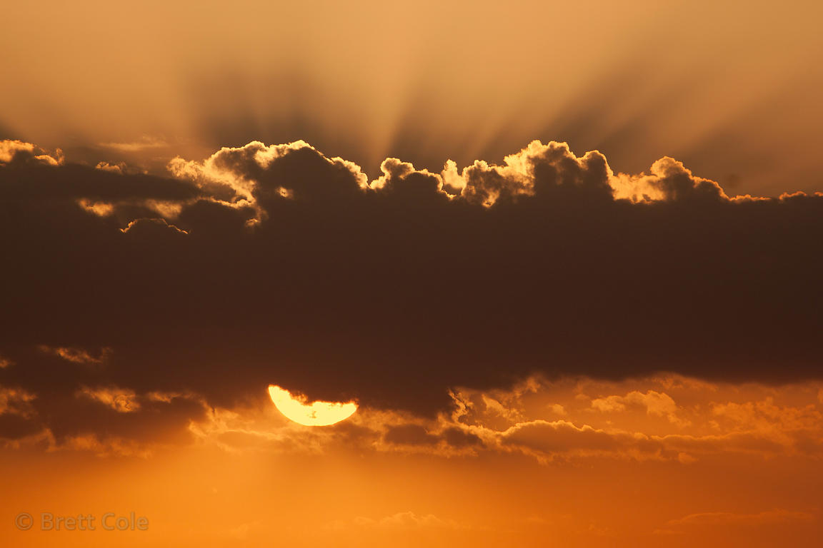 A beautiful sunset with cumulus clouds and visible sunrays, Pushkar, Rajasthan, India.