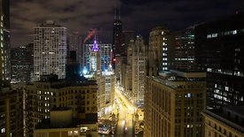 Bird's Eye: Wide Shot - Night to Day - The Progression of Sun Painting Morning Rush Hour on Michigan Avenue, Looking North, T...