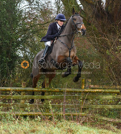 Fiona Gibson jumping a hunt jump in Holwell. The Belvoir Hunt at Hill Top Farm 1/12