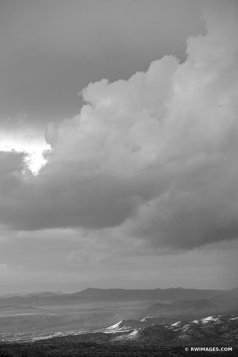 SUNSET CLOUDS ENCHANTING LIGHT NORTHERN NEW MEXICO LANDSCAPE BLACK AND WHITE VERTICAL
