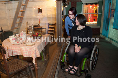 Young woman in a wheelchair discovering a museum