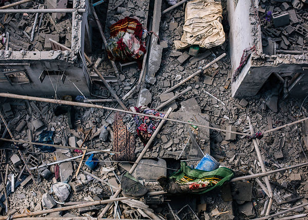 Palestinians walk in the rubble of destroyed houses in Gaza City's Shejaiya neighbourhood on August 19, 2014. United Nations ...