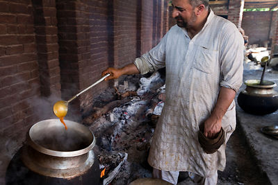 India - Srinagar - Mohammed Ayub, 43 a Waza or traditional cook in the Kashmiri tradition cooks and serves food at Wazwan fea...