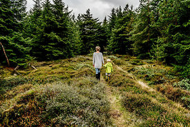Woman and child walking in the woods