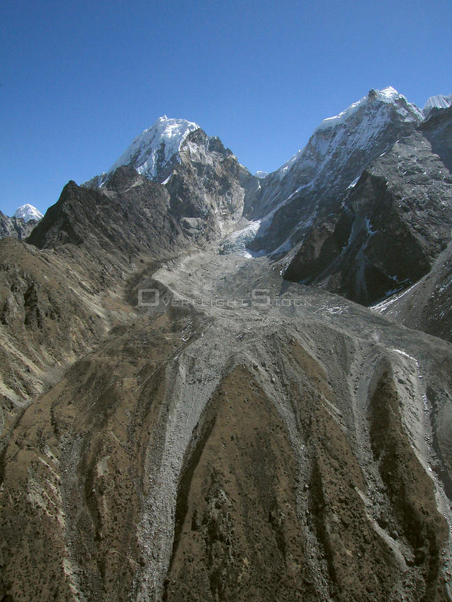 NEPAL Cholatse Glacier -- 16 Apr 2005 -- Glacial deposits left from the remainder of the Cholatse (Cholotse) Glacier, crowned...