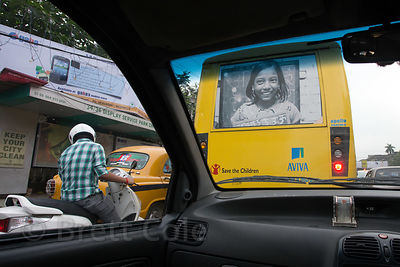 Save the Children NGO advertisement on the back of a bus in Beniapukur, Kolkata, India