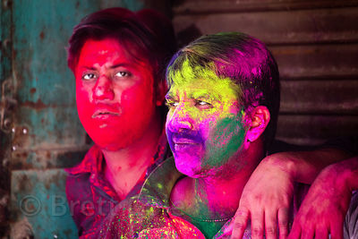 Men covered in gulal powder during the Holi festival, Pushkar, Rajasthan, India