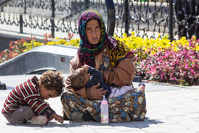 Roma woman with infant and child, Istanbul