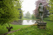 Upper Cascade is surmounted by a statue of Venus, in Venus' Vale, with Octagonal Pond beyond. Rousham House, Bicester, Oxon, UK