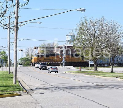Cars waiting at a railroad crossing in Homer Illinois as a Union Pacific Train goes through town
