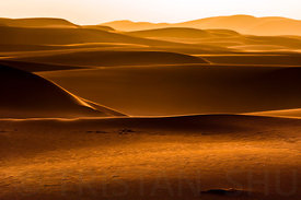 Sand, Dunes, wind and Sunset in the desert