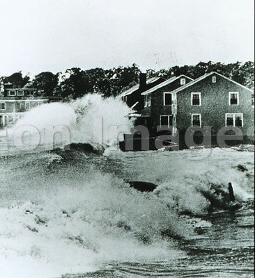 Waves  crash into homes during Hurricane Carol, 1954